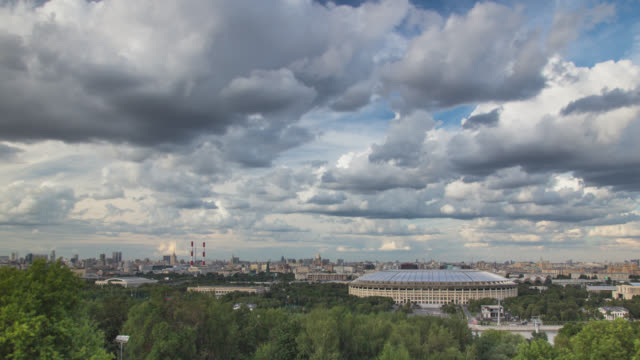 cityscape in a summer day with the movement of cumulus clouds in the sky - moskau stock-videos und b-roll-filmmaterial