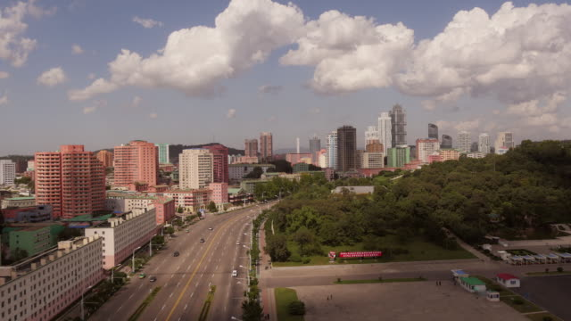 tl- cityscape in pyongyang during day with cloud shadows rolling over skyline at ryomyong street. shot from arch of triumph. north korea, dprk. wide shot from above. - capital cities stock videos & royalty-free footage