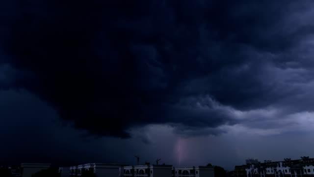 Cityscape lightning piercing night sky 4K Time Lapse Video