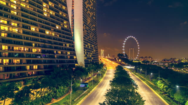 cityscape night with ferris wheel at singapore city, time lapse. - singapore flyer stock videos and b-roll footage