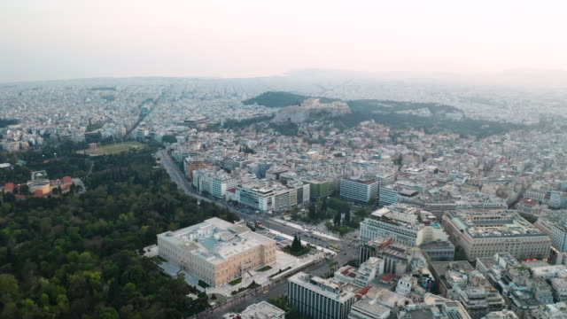cityscape of athens at sunset with the acropolis seen from lycabettus hill. aerial view. greece - lycabettus hill stock videos & royalty-free footage