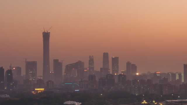 t/l pan cityscape of beijing in air pollution, dusk to night transition - air pollution stock videos & royalty-free footage