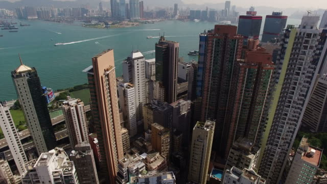 vídeos de stock, filmes e b-roll de cityscape of central district with two international finance center and buildings - hong kong
