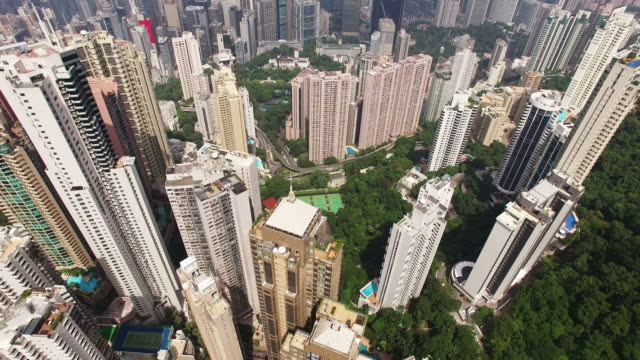 cityscape of central district with two international finance center and buildings - central district hong kong stock videos and b-roll footage