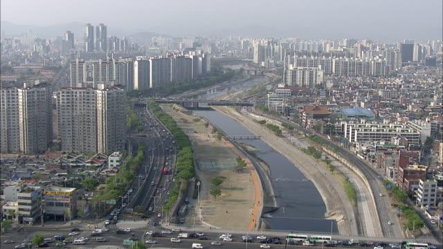 cityscape of daegu along the sincheon stream - daegu stock videos and b-roll footage