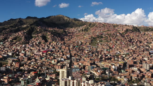 cityscape of la paz with rock mountain ranges / la paz, bolivia - la paz bolivia stock videos & royalty-free footage