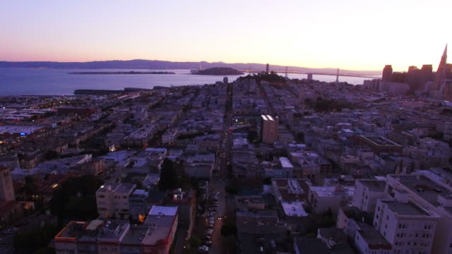 cityscape of lombard street at sunset - north beach san francisco stock videos and b-roll footage