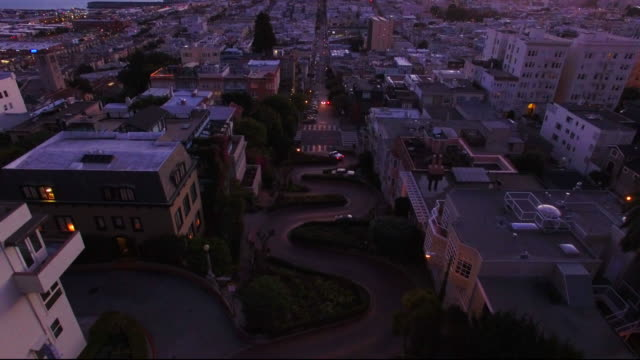 cityscape of lombard street at sunset - lombard street san francisco stock videos & royalty-free footage