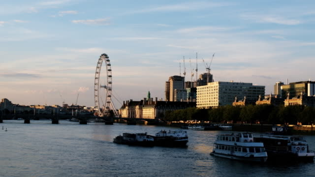 cityscape of london on the thames with the london eye and queen's walk shown - london eye stock videos & royalty-free footage