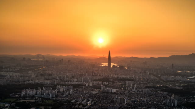 cityscape of lotte world tower(landmark of seoul) in downtown district at sunset to night - sunset to night stock videos & royalty-free footage