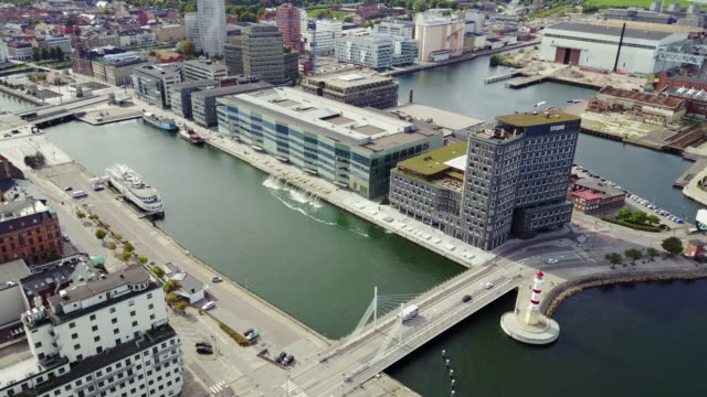cityscape of malmo, sweden - commercial dock and residential building complex - malmo stock videos and b-roll footage