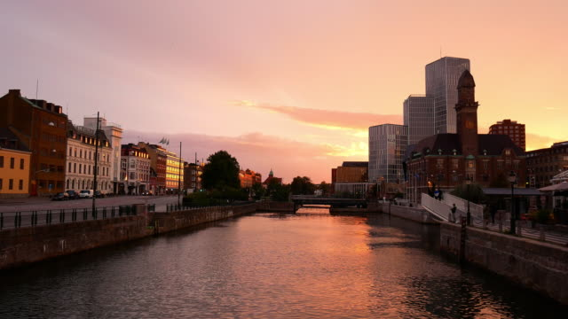 cityscape of malmo, sweden - sunset at canal - malmo stock videos and b-roll footage