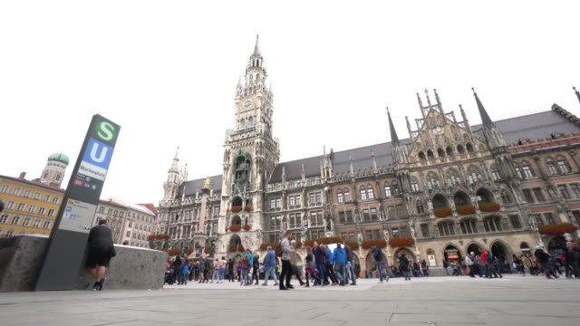 cityscape of marienplatz square at munich - town hall stock videos & royalty-free footage