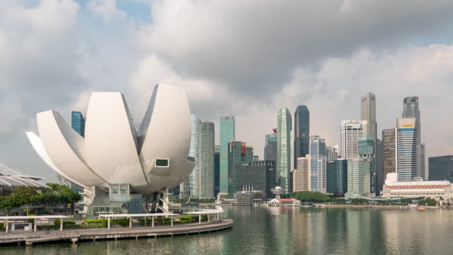 cityscape of marina bay with modern buildings, singapore, time lapse video - river singapore stock videos & royalty-free footage
