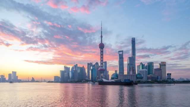 cityscape of modern city with sunrise in shanghai,timelapse,4k - shanghai stock videos & royalty-free footage
