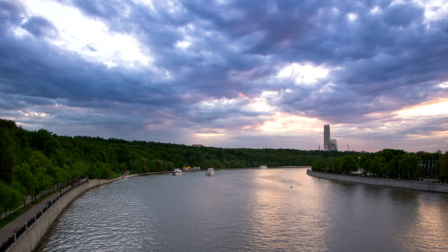 cityscape of moscow with river traffic and movement of the clouds at dusk - tourboat stock videos & royalty-free footage