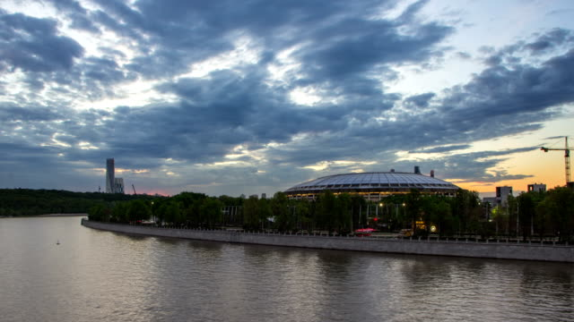 Cityscape of Moscow with river traffic and movement of the clouds at dusk