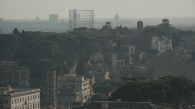 cityscape of rome gasometer in 4k - altare della patria stock videos and b-roll footage