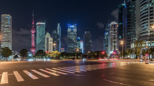 cityscape of shanghai with busy traffic,time lapse - appartamento video stock e b–roll