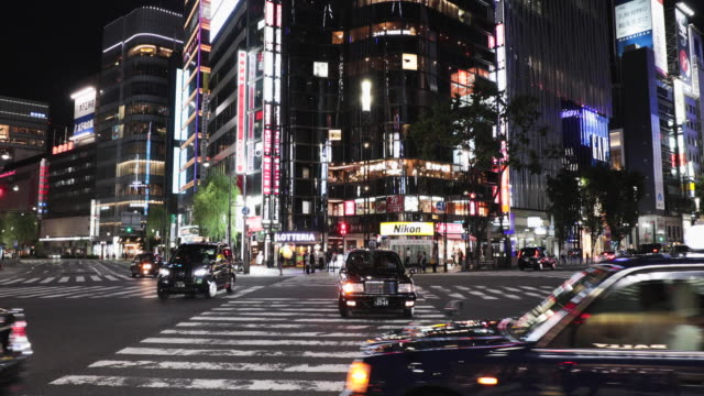 cityscape of tokyo at night - ginza stock videos & royalty-free footage