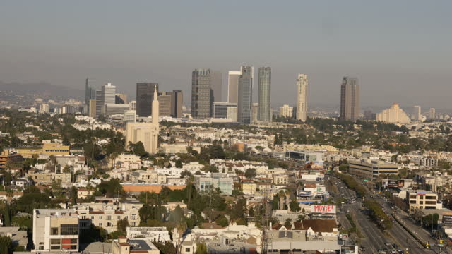 cityscape of west los angeles business and residential districts at sunset - century city stock videos & royalty-free footage