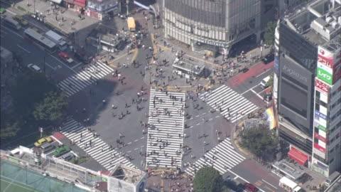 aerial, cityscape over shibuya, tokyo - shibuya crossing stock videos & royalty-free footage