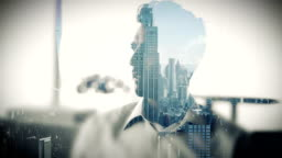 Cityscape overlay on businessman drinking coffee