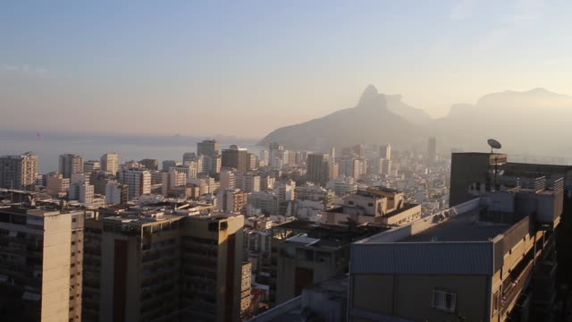 cityscape, residents of cantagalo favela watch as their team defeats colombia, making it to the next round of the fifa 2014 world cup, shot in... - ゴールを狙う点の映像素材/bロール