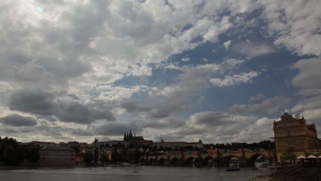 t/l ws cityscape seen across vltava river / prague, czech republic - river vltava stock videos & royalty-free footage