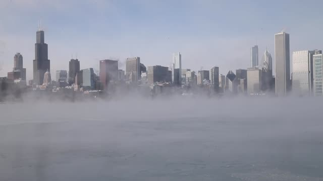 cityscape shot mist rises from lake michigan as temperatures dipped well below zero on january 6 2014 in chicago illinois chicago hit a record low of... - lago michigan video stock e b–roll