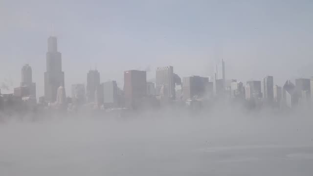cityscape shot mist rises from lake michigan as temperatures dipped well below zero on january 6 2014 in chicago illinois chicago hit a record low of... - lake michigan stock videos & royalty-free footage