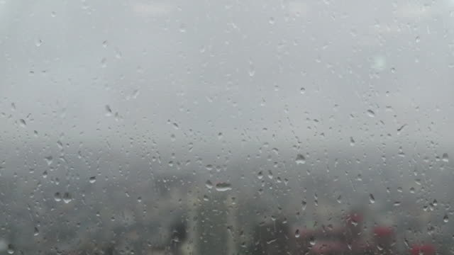 cityscape through a glass window with raindrops in skyscrapers - jp201806 stock videos and b-roll footage