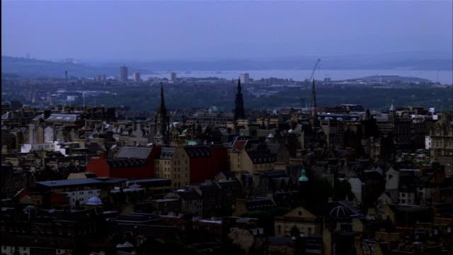 HIGH ANGLE WIDE PAN of cityscape to Edinburgh Castle, seen from Arthur's Seat, Edinburgh, Scotland