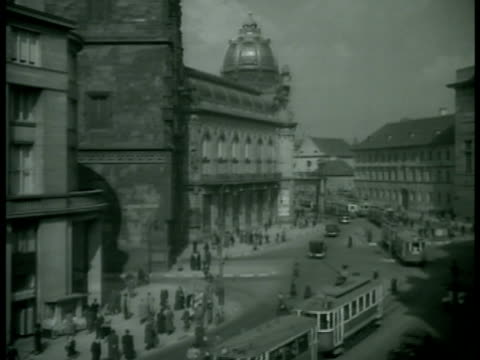 cityscape w/ trams moving on street municipal house building dome in old town - stare mesto stock videos and b-roll footage