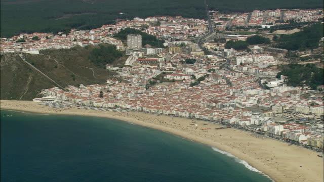 AERIAL WS Cityscape with beach / Nazare, Leria, Portugal