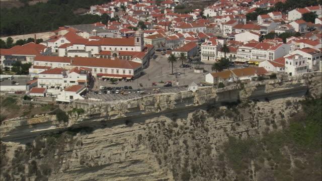 AERIAL WS ZO Cityscape with beach / Nazare, Leria, Portugal
