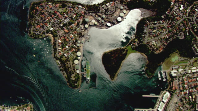 WS AERIAL Cityscape with boats moving through harbor, Sydney, New South Wales, Australia