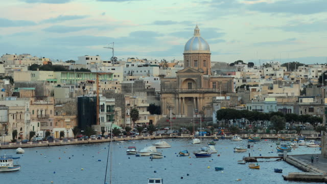 t/l ws ha zo cityscape with boats on sea at kalkara, with cathedral prominent / valletta, malta - valletta stock videos & royalty-free footage