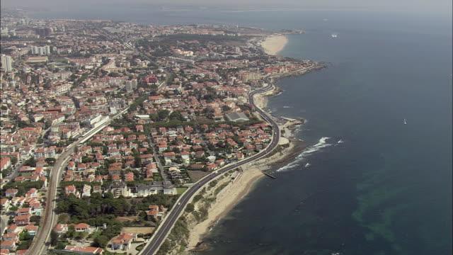 aerial ws cityscape with coastal road / cascais, lisbon, portugal - cascais stock videos and b-roll footage