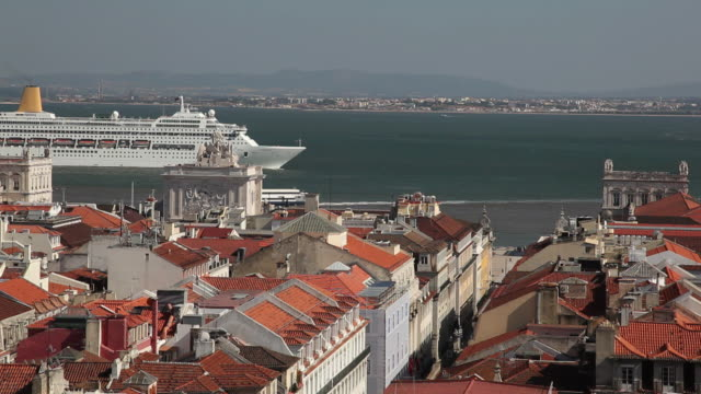WS HA Cityscape with cruise ship moving past / Lisbon, Portugal