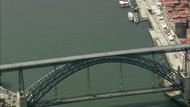 aerial ws cityscape with dom luis 1st bridge on duero river / porto, portugal - ポルトガル点の映像素材/bロール