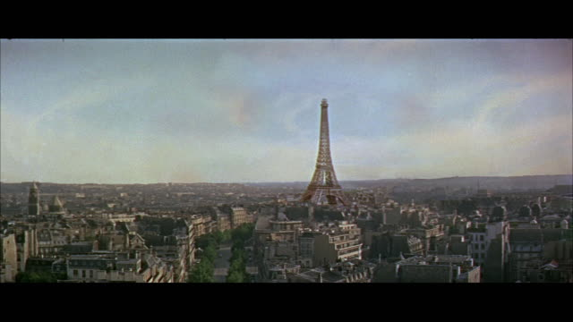 ws cityscape with eiffel tower crumbing down / paris, france - eiffel tower stock videos and b-roll footage