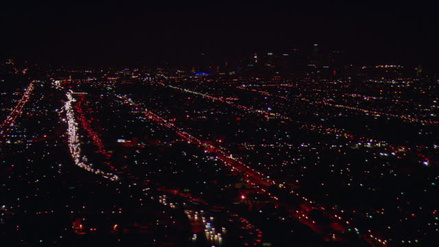 vídeos de stock, filmes e b-roll de aerial cityscape with harbor freeway and downtown los angeles illuminated at night, los angeles, california, usa - 2009