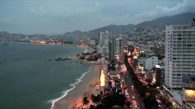 WS HA Cityscape with high rise buildings along coastline at dusk, Acapulco de Juarez, Guerrero, Mexico