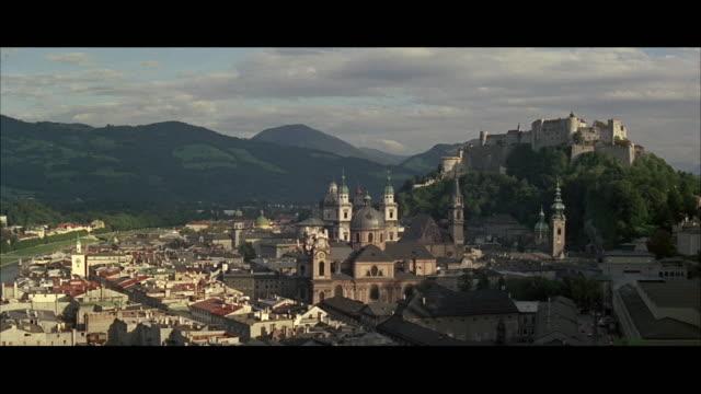 vidéos et rushes de ws cityscape with hohensalzburg castle in background / salzburg, austria - austria