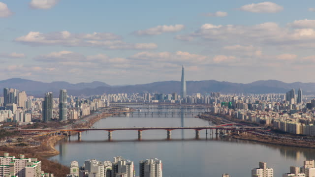 cityscape with lotte world tower and seongsudaegyo bridge / han river, seongdong-gu, seoul, south korea - cumulus stock videos & royalty-free footage