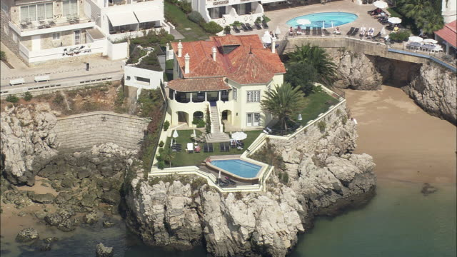 aerial ws cityscape with luxury hotels and resorts / cascais, lisbon, portugal - cascais stock videos and b-roll footage