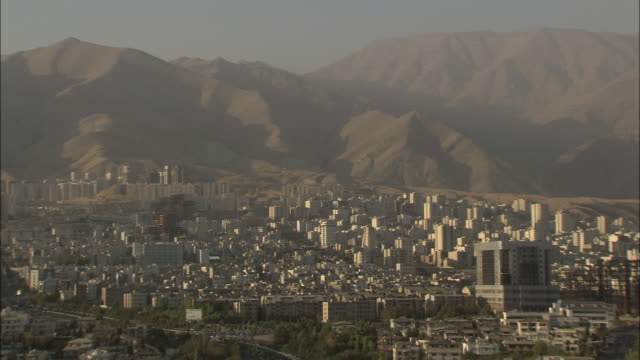 WS Cityscape with mountains in background at sunset / Teheran, Iran