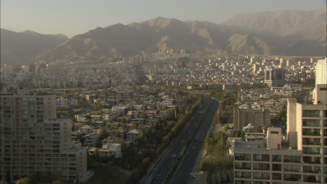 ws ha cityscape with mountains in background at sunset / teheran, iran - tehran stock videos and b-roll footage