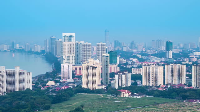 cityscape with river and tower in penang, malaysia - penang stock videos and b-roll footage
